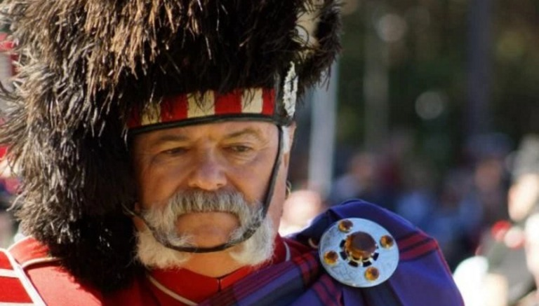 Stone Mountain Highland Games bagpipe leader looking serious.