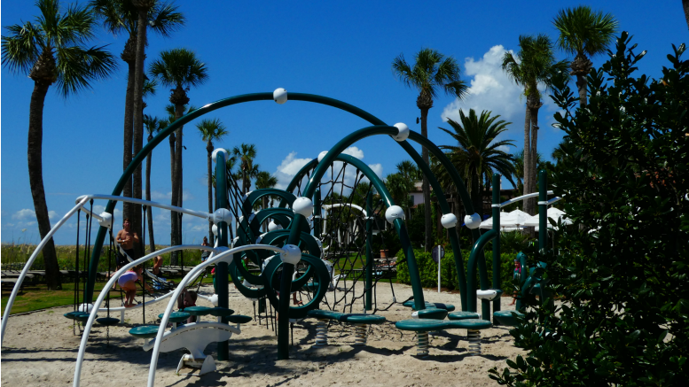 The playground at the Beach Club at The Cloister at Sea Island has the pool on one side, and the beach on the other.